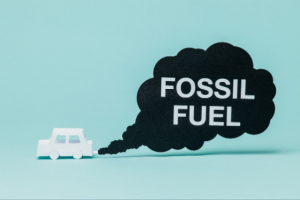 A rendering of a white car with a dark cloud of black smock coming from the back with the words Fossil Fuel in all caps written within the smoke.